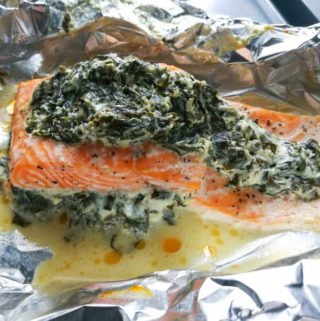 Stuffed salmon fillet on aluminion foil paper