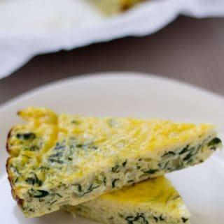 A plate with Spinach and Zucchini Crustless Quiche, an easy and simple recipe with a ton of flavor, made with eggs and cheese.