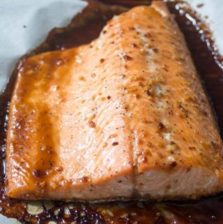 Honey Teriyaki salmon fillet on a baking sheet.