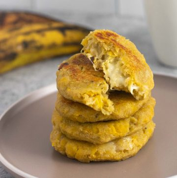 Cooked stuffed plantain arepas with cheese