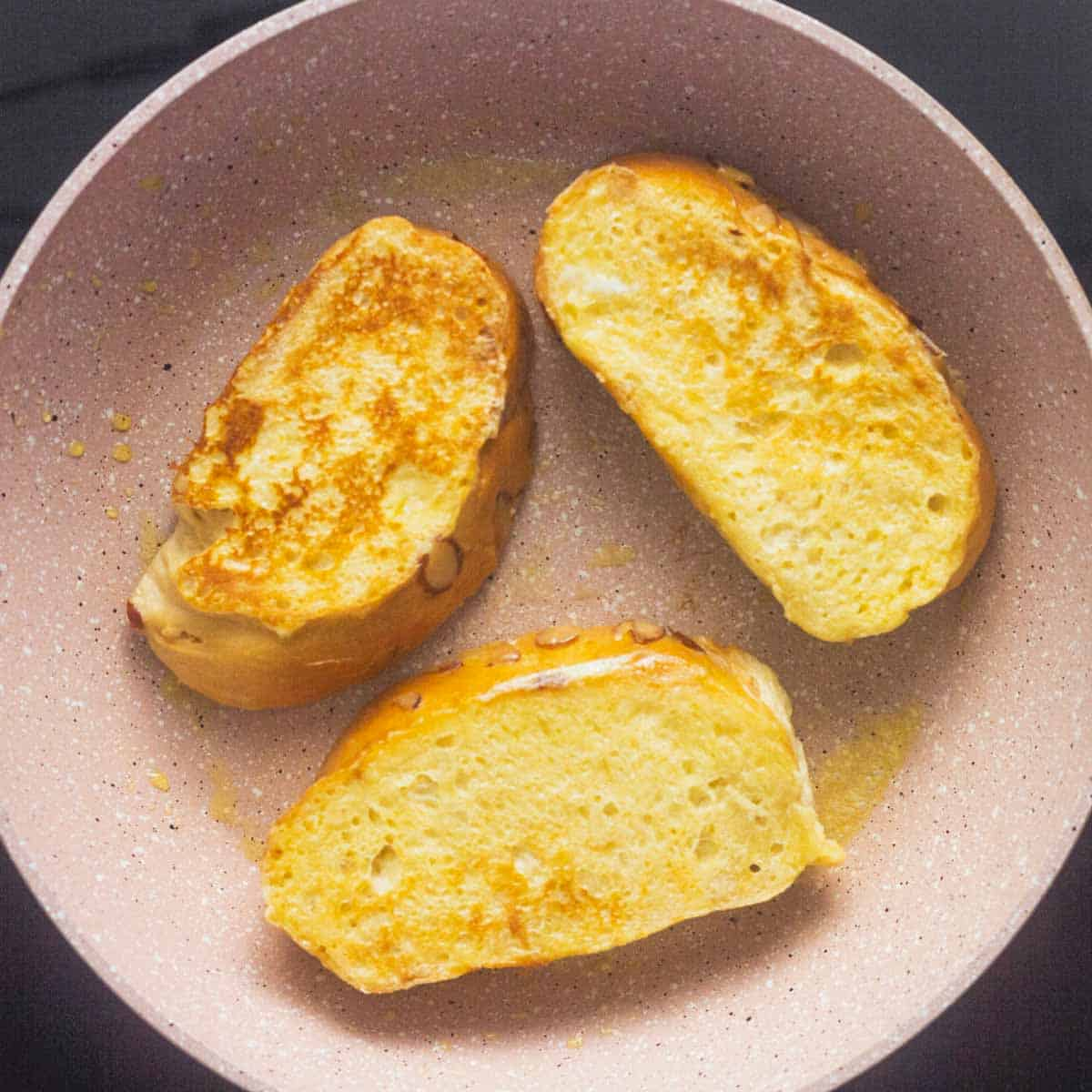cooked french toast on frying pan