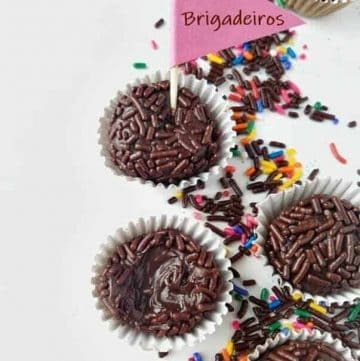 four chocolate brigadeiros with sprinkles