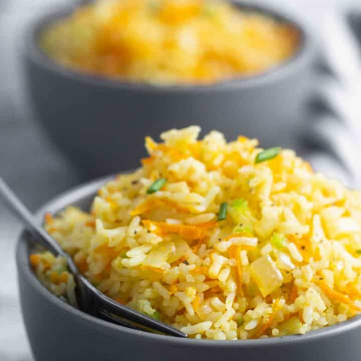two bowls served with rice and carrots