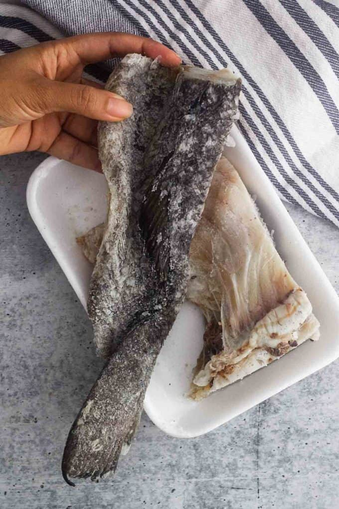 top view of salted cod part of the skin with coarse salt